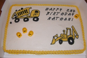 A construction vehicle cake for a child's second birthday.